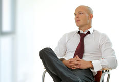 Businessman sitting on office chair Royalty Free Stock Photos
