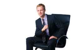 Businessman sitting in office chair Royalty Free Stock Photo