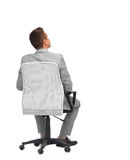 Businessman sitting in office chair from back Stock Photo