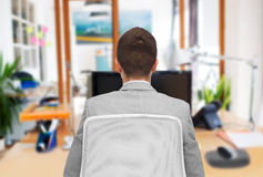 Businessman sitting in office chair from back Royalty Free Stock Image