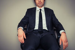 Businessman sitting in office chair Royalty Free Stock Photos