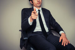 Businessman sitting in office chair Royalty Free Stock Image
