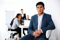 Businessman sitting on the office chair Stock Image