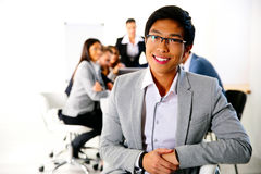 Businessman sitting on the office chair Royalty Free Stock Images
