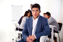 Businessman sitting on the office chair Royalty Free Stock Photo