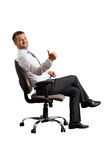 Businessman sitting on the office chair Royalty Free Stock Image