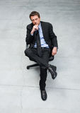 Businessman sitting on an office chair Royalty Free Stock Photos
