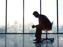 Businessman sitting in office Stock Image