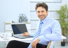 Businessman sitting at office desk Stock Photo