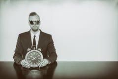 Businessman sitting at office desk Stock Photo