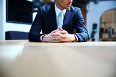 Businessman sitting at office Royalty Free Stock Image
