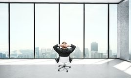 Businessman sitting in office Stock Images