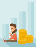 Businessman is sitting with pile of gold coins on Royalty Free Stock Image