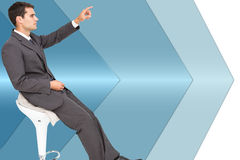 Businessman sitting and pointing the finger Stock Photo