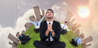 Businessman sitting praying and looking up Royalty Free Stock Photos