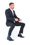 Businessman sitting put his hands front Stock Photography