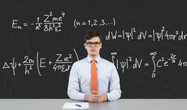 Businessman sitting in school Stock Photography