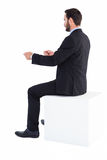 Businessman sitting and showing something with his hands Royalty Free Stock Images