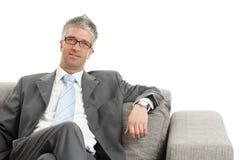 businessman sitting sofa Στοκ Φωτογραφία