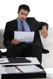 Businessman sitting on a sofa Stock Image