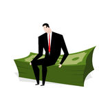 Businessman sitting on stack of dollars. Businessman and profit. Royalty Free Stock Photography