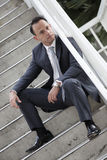 Businessman sitting on a staircase Stock Images