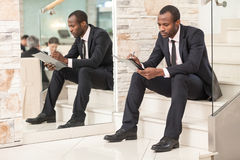 Businessman sitting on stairs Stock Photography
