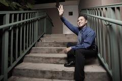 Businessman sitting on steps Royalty Free Stock Photos