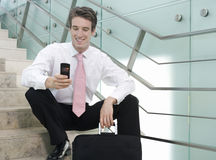 A businessman sitting on steps Royalty Free Stock Photos