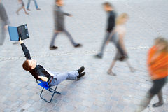 Businessman sitting at the street Royalty Free Stock Photo