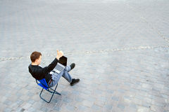 Businessman sitting at the street Royalty Free Stock Photography