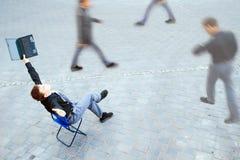 Businessman sitting at the street Stock Photos