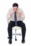 Businessman sitting on swivel chair shouting Royalty Free Stock Photo