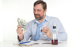 Businessman sitting at a table Stock Image
