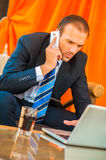 Businessman sitting at table in cafe Stock Images