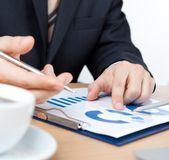 Businessman sitting at the table with documents Stock Images