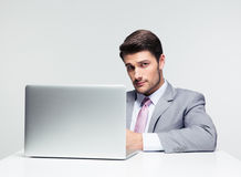 Businessman sitting at the table with laptop royalty free stock photos