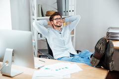Businessman sitting at the table with laptop and relaxing Royalty Free Stock Photography