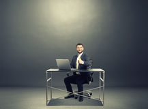 Businessman sitting at the table with laptop Royalty Free Stock Photo
