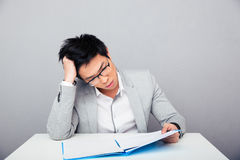 Businessman sitting at the table Royalty Free Stock Photos