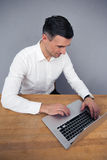 Businessman sitting at the table and using laptop Royalty Free Stock Photography