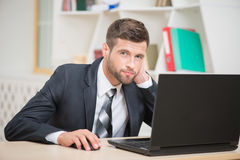 Businessman sitting at the table and working with Royalty Free Stock Photo