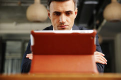 Businessman sitting with tablet computer Royalty Free Stock Images