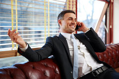 Businessman sitting and talking on the phone Royalty Free Stock Photography