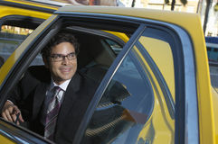 Businessman Sitting In Taxi Royalty Free Stock Photography