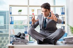 The businessman sitting on top of desk in office Stock Photos