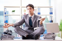 The businessman sitting on top of desk in office Royalty Free Stock Photos