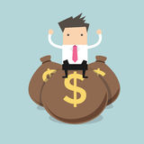 Businessman sitting on top of a pile of dollar money bags. Vector illustration Stock Photos