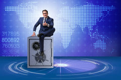 The businessman sitting on top of safe Stock Photography