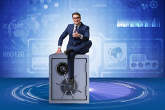 The businessman sitting on top of safe Royalty Free Stock Photo